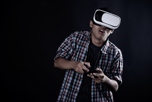 Student man wearing virtual reality goggles, vr headset. Free Photo