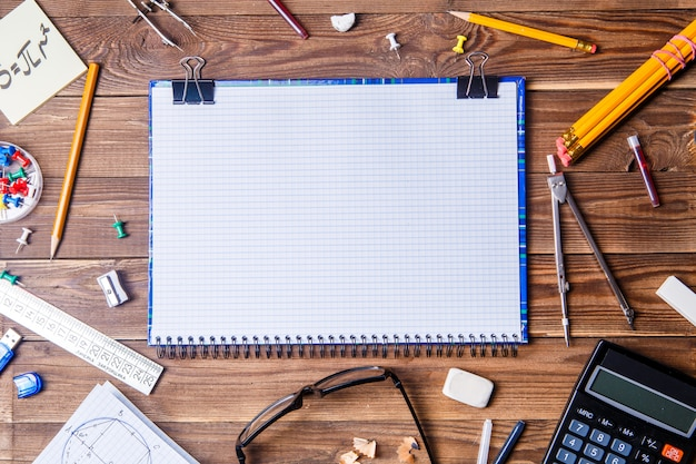 Student material with copybook for text on wooden table. Premium Photo