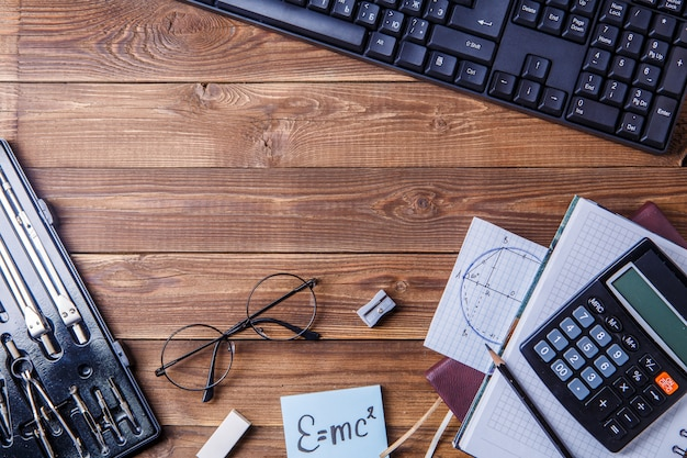 Student material on wooden table with copyspace. Premium Photo
