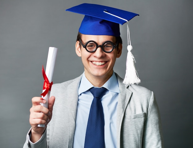 Student showing his diploma Free Photo
