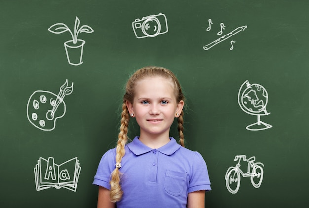 Student with blackkboard full of drawings Free Photo