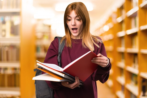 Student woman reading book on unfocused background. back to school Premium Photo