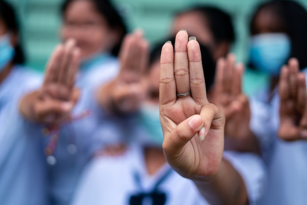 Students girl showing three finger salute in school Premium Photo