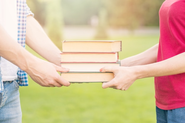 Students holding books in park Free Photo