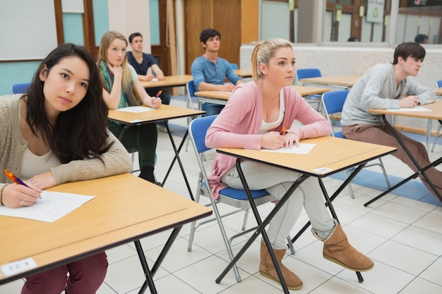 Students sitting at the classroom Premium Photo
