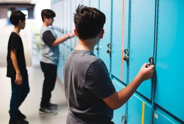 Students standing at the lockers Premium Photo
