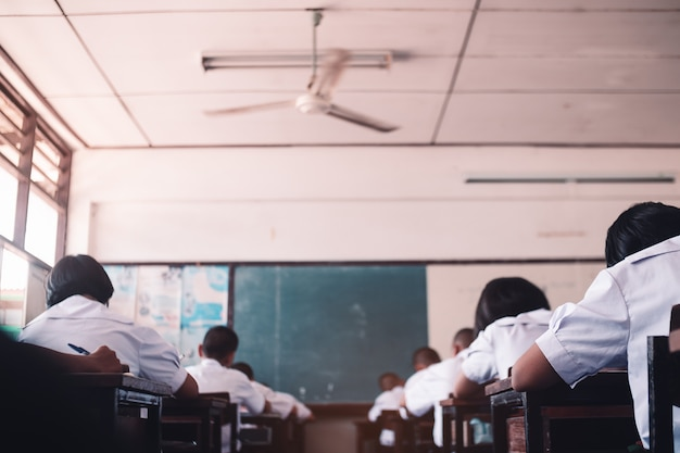Students taking exam with stress in school classroom Premium Photo