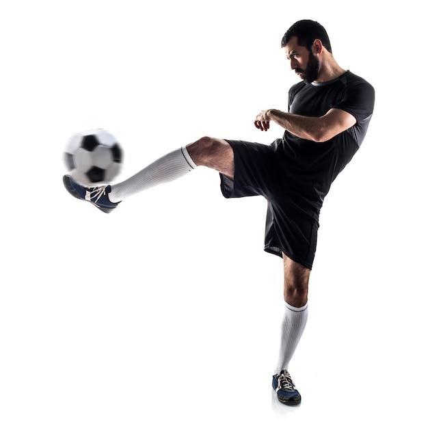 Studio latin guy kicking athlete Free Photo