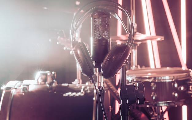 Studio microphone and headphones on a close-up stand, in a recording studio or concert hall. Premium Photo