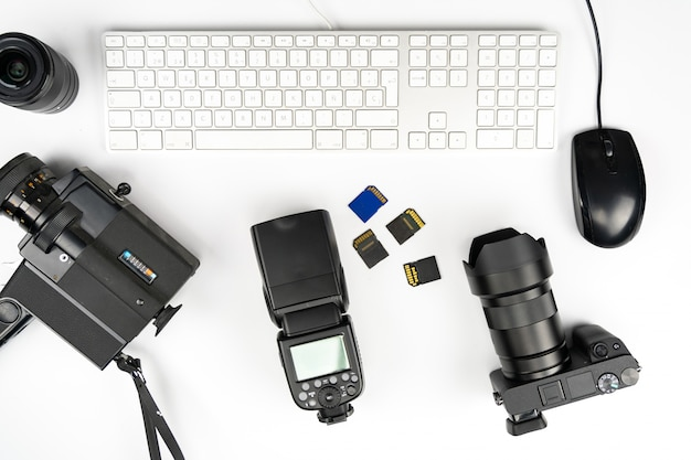 Studio photography with computers, cameras, flashes and multiple lens Premium Photo