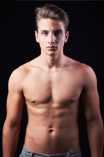 Handsome Young Bodybuilder Shirless, Isolated on Black
