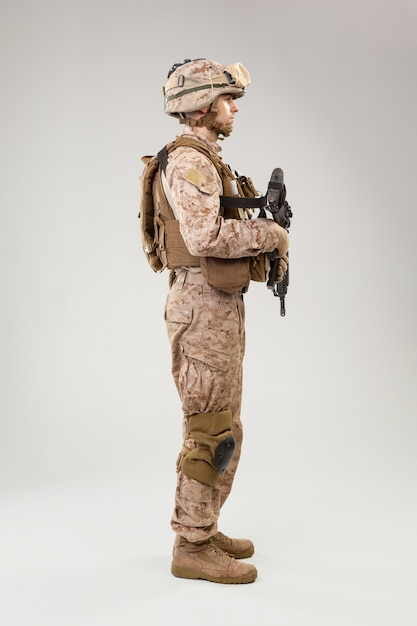 Studio shoot of modern infantry soldier, u.s. marine rifleman in combat uniform, helmet and body armor Premium Photo