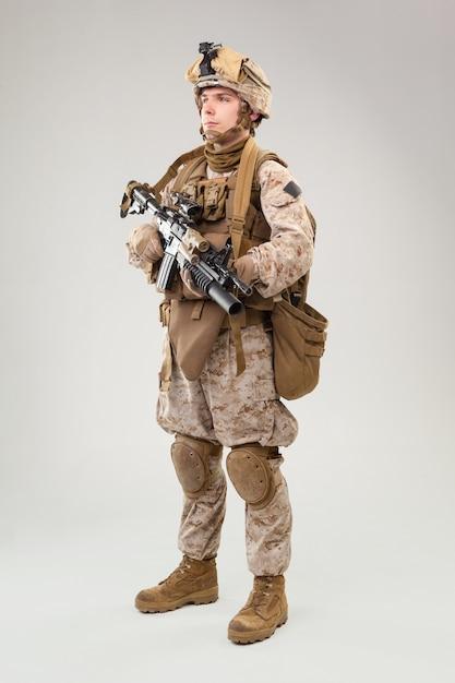 Studio shoot of modern infantry soldier, u.s. marine rifleman in combat uniform, helmet and body armor Premium Photo