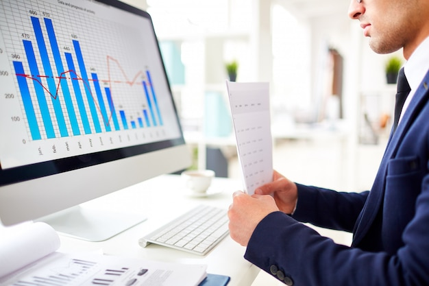 Studying sales chart Free Photo
