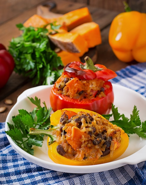 Stuffed peppers with rice, beans and pumpkin in the mexican style Premium Photo