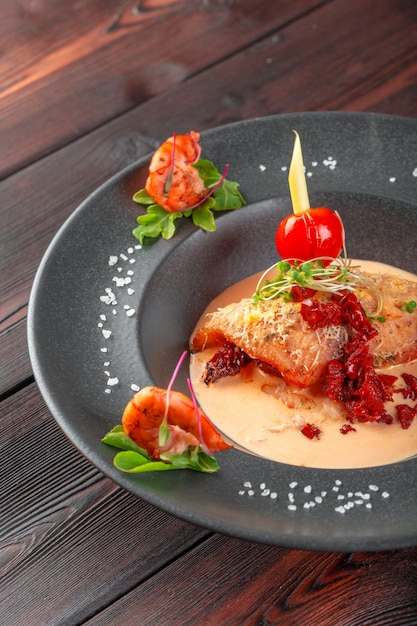 Stuffed squid with parmesan cheese, onion and parsley in tomato sauce Premium Photo