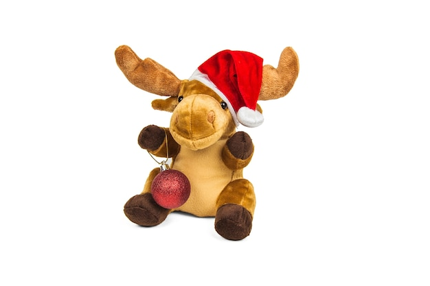 Stuffed toy christmas deer in santa claus hat isolated on white wall Premium Photo