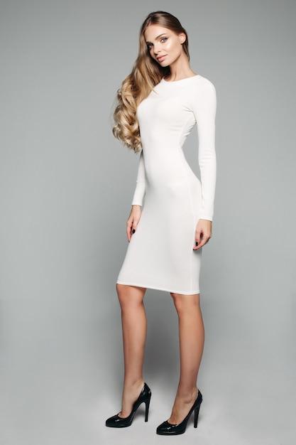Stunning blonde girl in white simple dress Premium Photo