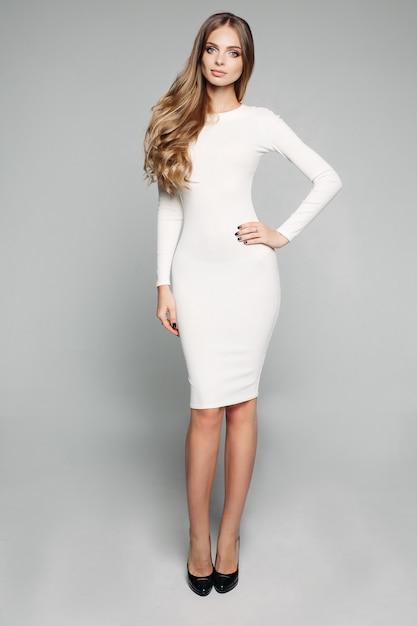Stunning blonde girl in white Premium Photo