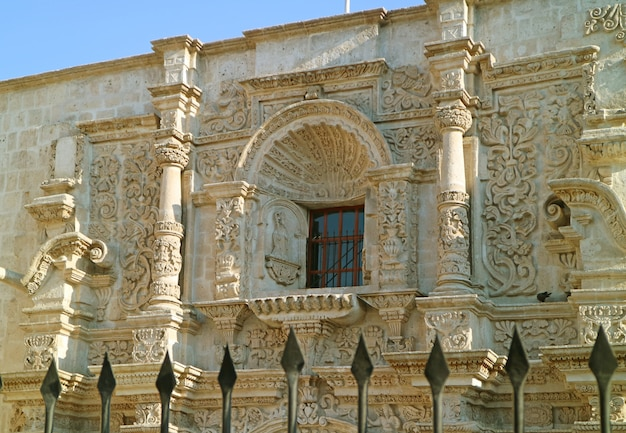 Stunning sillar stone carving facade of the church of saint augustine in arequipa, peru Premium Photo