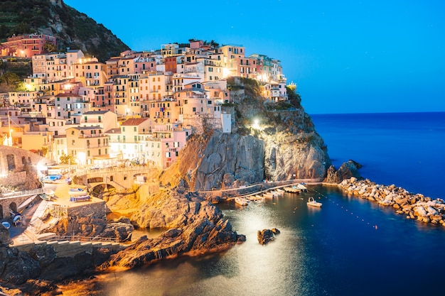 Stunning view of the beautiful and cozy village of manarola in the cinque terre reserve at sunset, Premium Photo