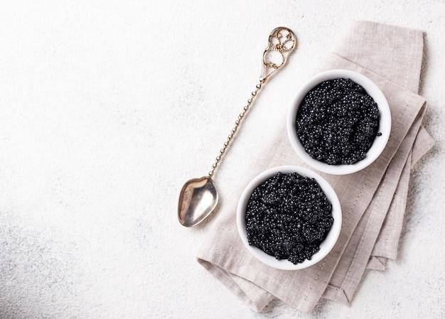Sturgeon black caviar in bowls Premium Photo