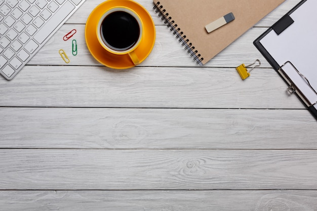 Styled stock photography white office desk table with blank notebook, keyboard, macaroon, supplies and coffee cup. top view with copy space. flat lay. Premium Photo
