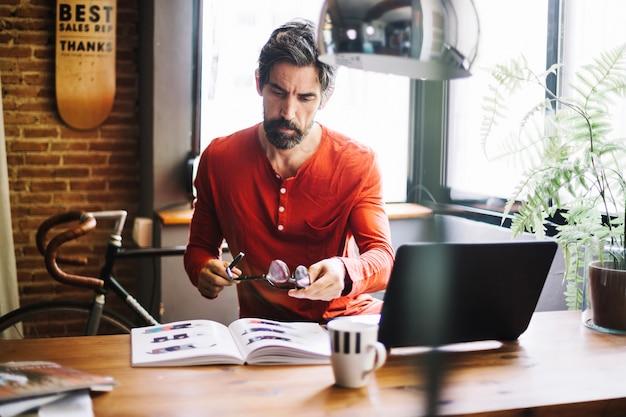 Stylish adult man working at desktop Free Photo