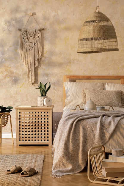 Premium Photo Stylish Bedroom Interior With Design Coffee Table Furniture Plant Carpet Rattan Decoration And Elegant Personal Accessories Beautiful Beige Bed Sheets Blanket And Pillows