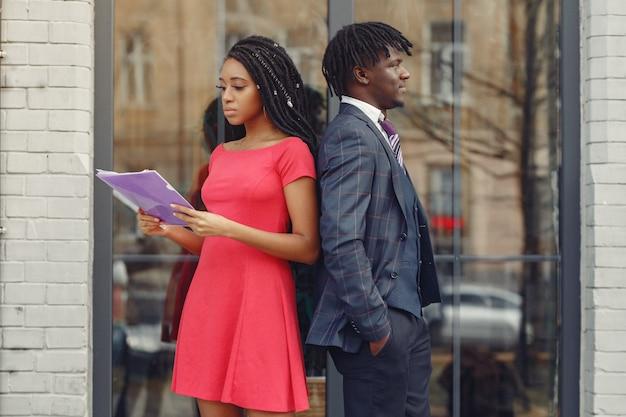 Stylish black couple have business conversation Free Photo