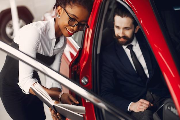 Stylish black woman in a car salon Free Photo