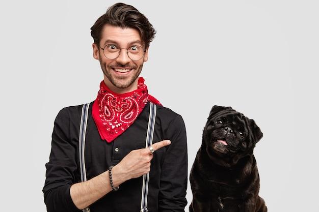 Stylish brunet man wearing red bandana next to dog Free Photo