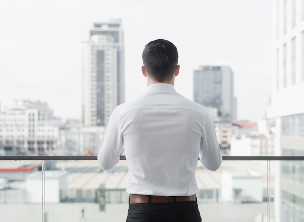 Stylish business man back shot Premium Photo