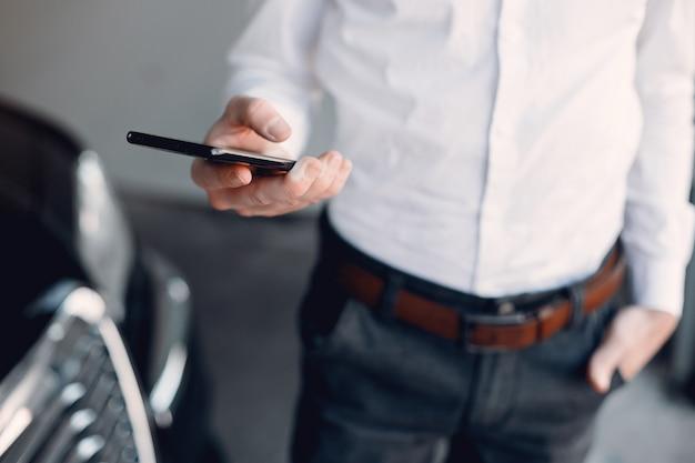 Stylish businessman working near the car Free Photo