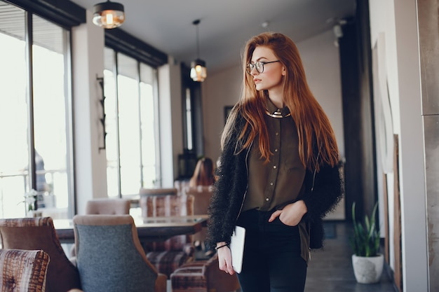 Stylish businesswoman in a cafe Free Photo