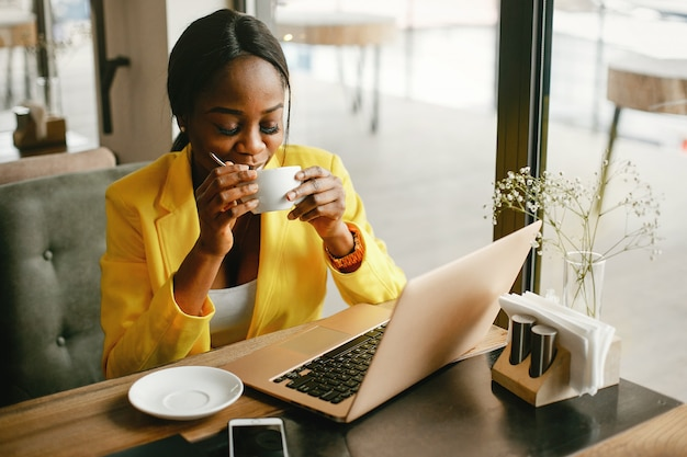 Stylish businesswoman working in a office Free Photo