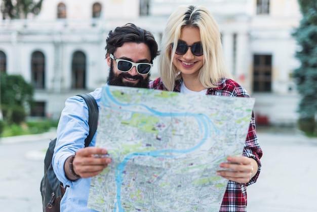 Stylish couple on vacation Free Photo