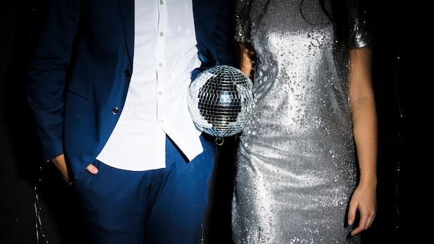 Stylish couple with disco ball Free Photo