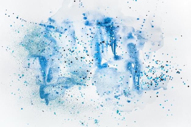 スパンコール付きのブルーでスタイリッシュな創造的な水彩画。 無料写真