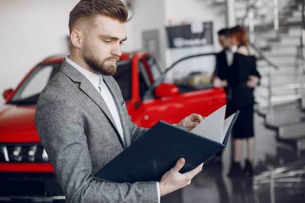 Stylish and elegant couple in a car salon Free Photo