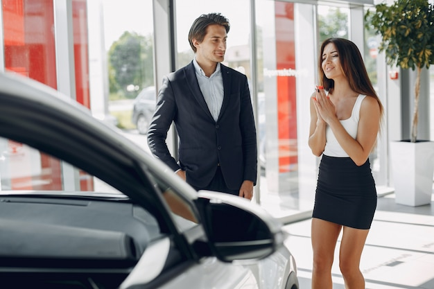 Stylish and elegant couple in a car salon Free Photo