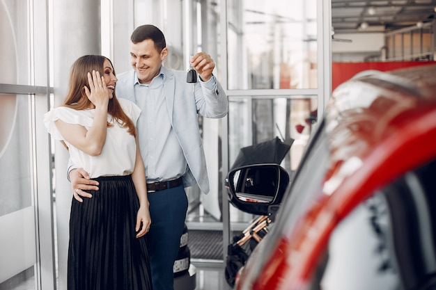Stylish and elegant family in a car salon Free Photo