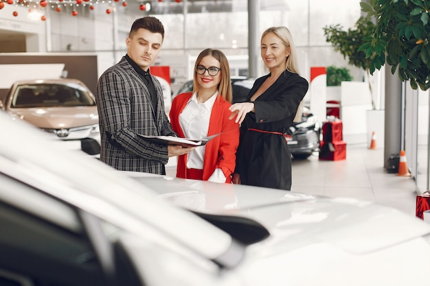 Stylish and elegant people in a car salon Free Photo