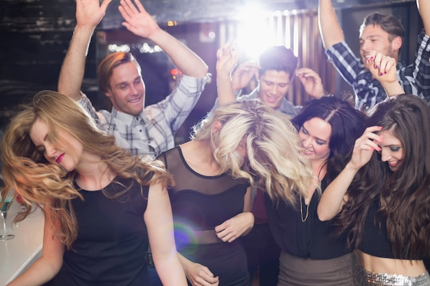 Stylish friends dancing and smiling Premium Photo