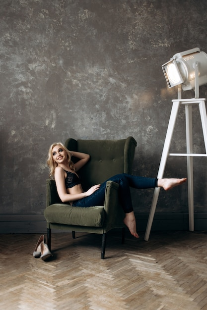 The stylish girl sits on the chair Free Photo