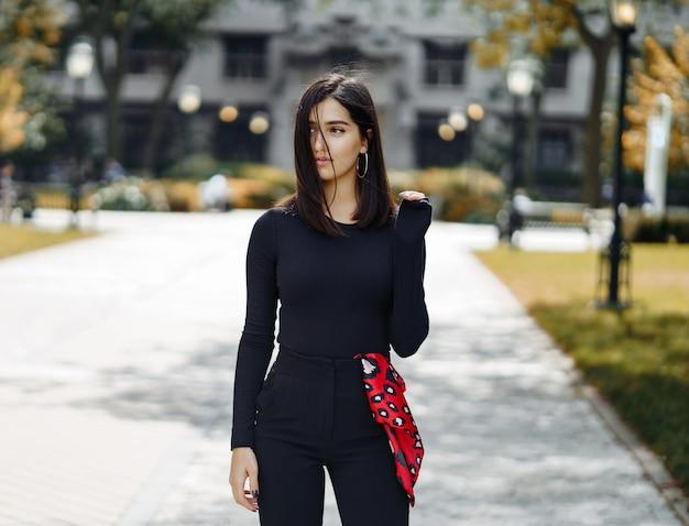 Stylish girl walking through her school's campus Free Photo