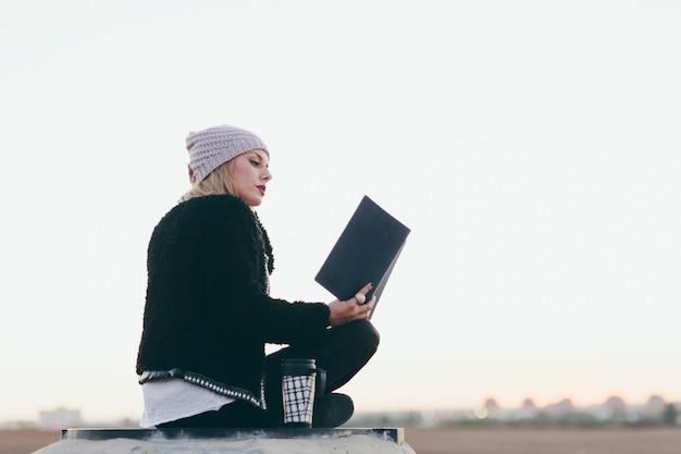 Stylish girl with notepad on nature Free Photo