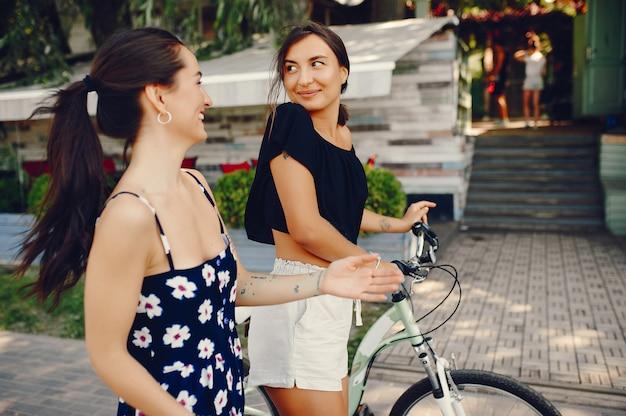 Stylish girls walking in a summer park Free Photo