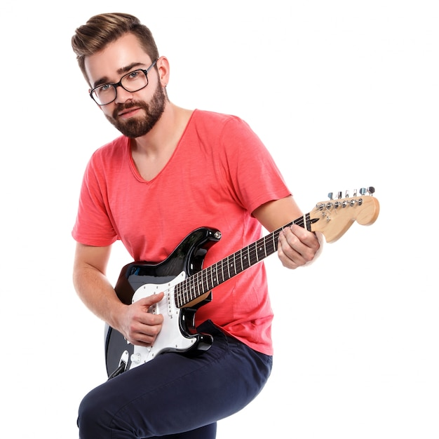Stylish guy with a guitar Premium Photo