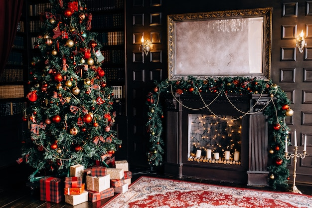 Stylish interior of room with beautiful christmas fir tree and decorative fireplace Premium Photo